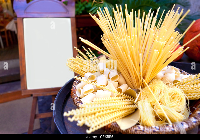 composition of many sorts of italian pasta with menu - Stock Image