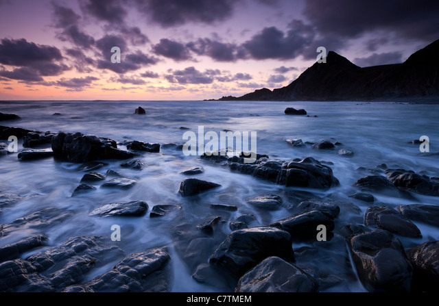 Twilight over the rocky shores of Spekes Mill Mouth, North Devon, England. Summer (June) 2011. - Stock Image