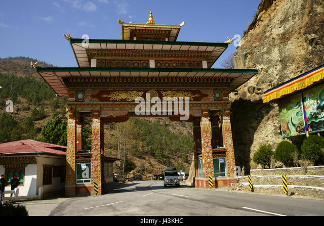 Gate over road to Thimphu at intersection with Paro road, Bhutan - Stock Image