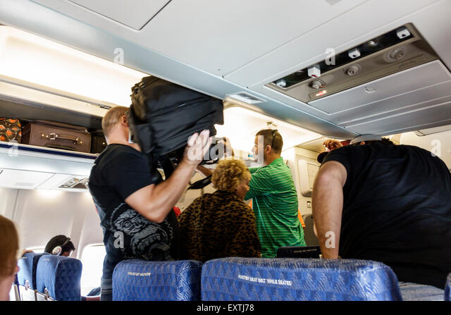 Dallas Texas Dallas Ft. Fort Worth International Airport DFW American Airlines aircraft cabin arrival overhead bin - Stock Image