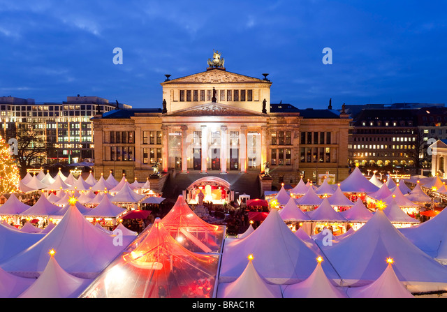 Traditional Christmas Market at Gendarmenmarkt, illuminated at dusk, Berlin, Germany, Europe - Stock Image