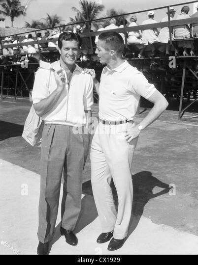 Hugh (Wyatt Earp) O'Brien and tennis pro Tony Trabert in Palm Beach, Florida, ca 1955 - Stock Image