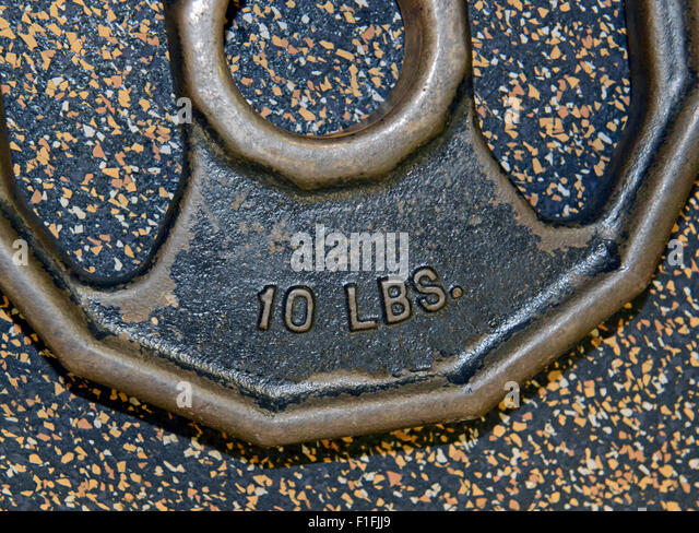 iron weight plates and exercise equipment at gym - Stock-Bilder