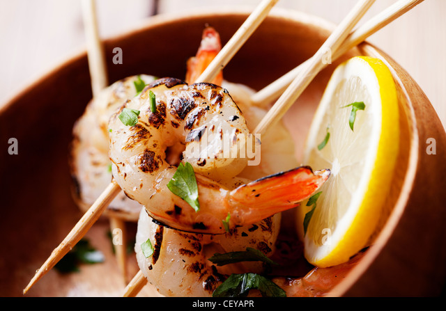 fresh grilled shrimps close up - Stock Image