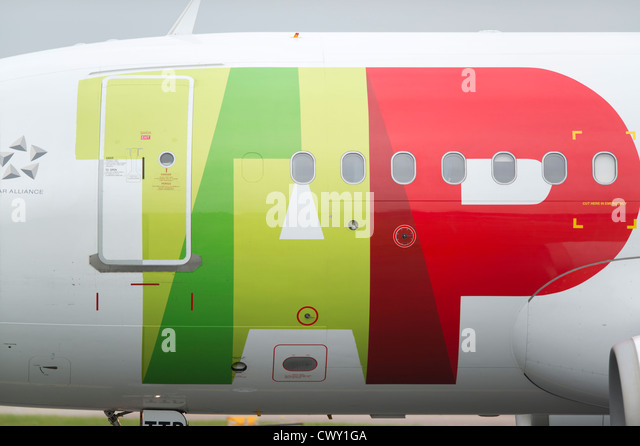 A close up of the TAP Portugal logo on the fuselage of a passenger aircraft (Editorial use only) - Stock Image