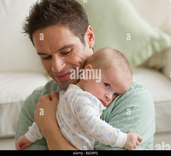 Father hugging baby - Stock-Bilder