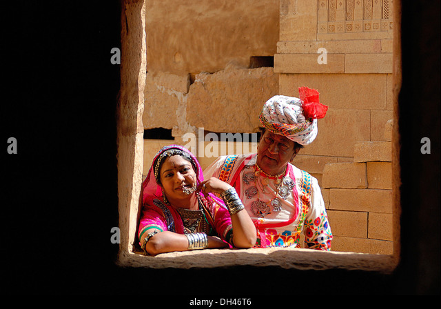 Indian man and woman in traditional dress Jaisalmer Rajasthan India Asia   MR#784B&784C - Stock Image