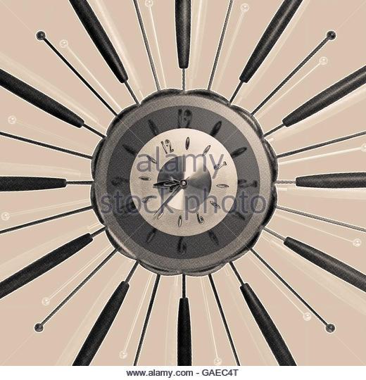 Star burst clock vintage retro mid century style photo illustration - Stock Image