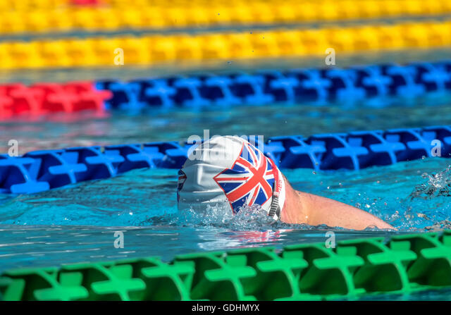 Trisome Games 2016. Florence, Italy. UK athlete performing on the main swimming pool. - Stock Image