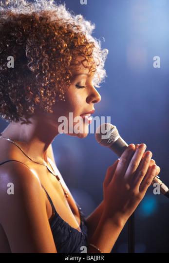 Jazz singer on stage, profile - Stock Image