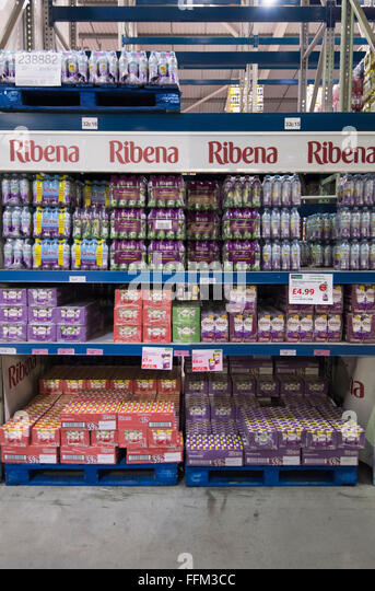Boxes of sugary soft drink Ribena in a warehouse stockroom. - Stock Image