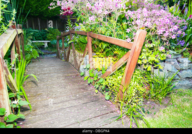 Wooden garden bridge stock photos wooden garden bridge for Typical landscaping plants