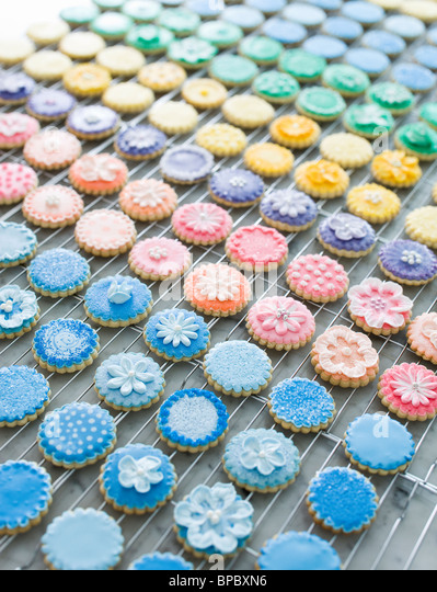 Beautiful multicolored frosted cookies in kitchen - Stock-Bilder