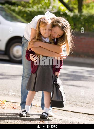 Mother and daughter hugging - Stock-Bilder