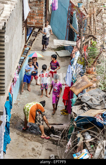 Mumbai India Asian Dharavi Kumbhar Wada slum shanties high population density poverty low income poor residents - Stock Image