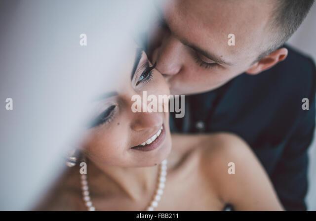 Beautiful European bridal couple in the hotel room - Stock-Bilder