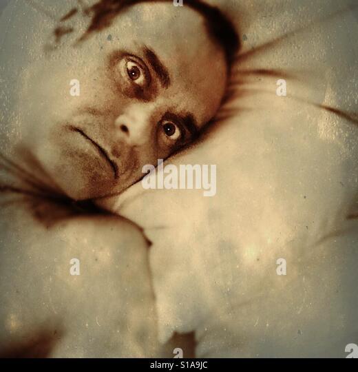 Man in a bed. - Stock-Bilder