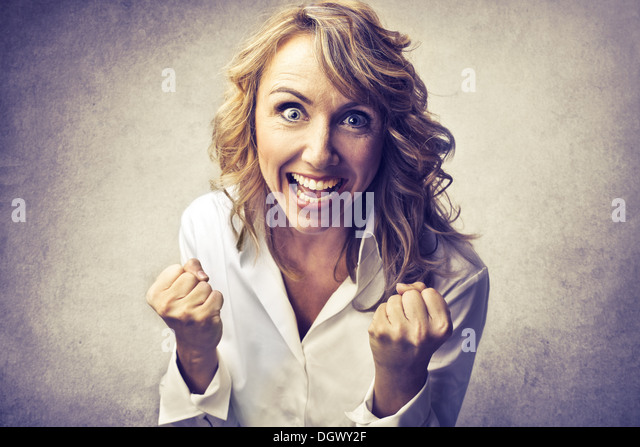Blonde woman rejoicing - Stock Image