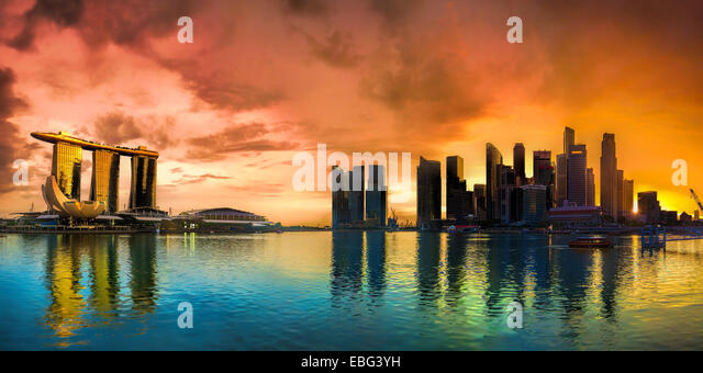 Panorama of Singapore city skyline at sunset - Stock Image