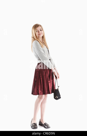 Girl with purse, smiling, portrait - Stock Image