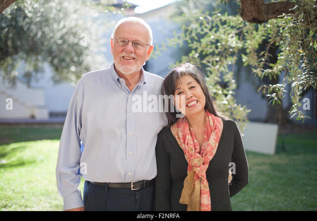 Older couple smiling in backyard - Stock-Bilder