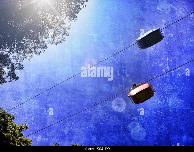 Cable cars backlit by sun - Stock Image