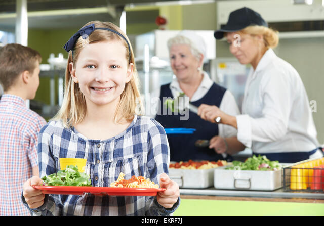 Female Pupil With Healthy Lunch In School Canteen - Stock Image