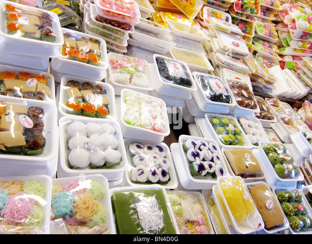 sweets for sale in food market in Bangkok Thailand - Stock Image