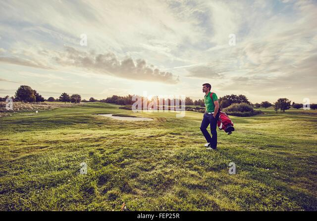 Golfer walking on course, Korschenbroich, Dusseldorf, Germany - Stock Image