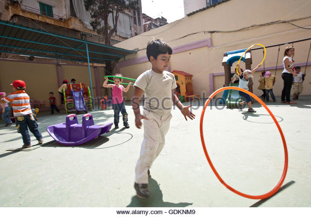 Lebanon - Beirut - Kids playing in the school's playground. JCC Kindegarden in Sabra refugee camp. - Stock Image