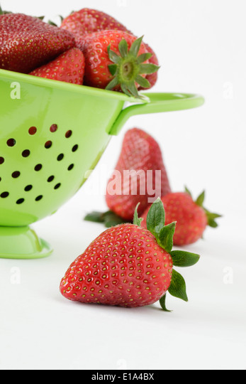 Fresh Strawberries and green colander - Stock Image