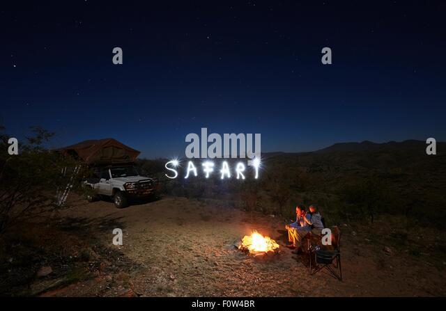 Family at campfire, Gamsberg Pass, Namibia - Stock Image