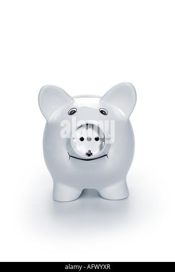 piggy bank with power plug Sparschwein mit Steckdose - Stock Image