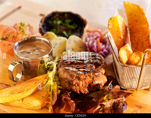 rustic steak and chips - Stock Image