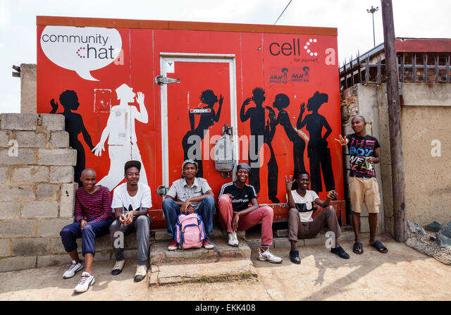 South Africa African Johannesburg Soweto Black man friends sitting - Stock Image