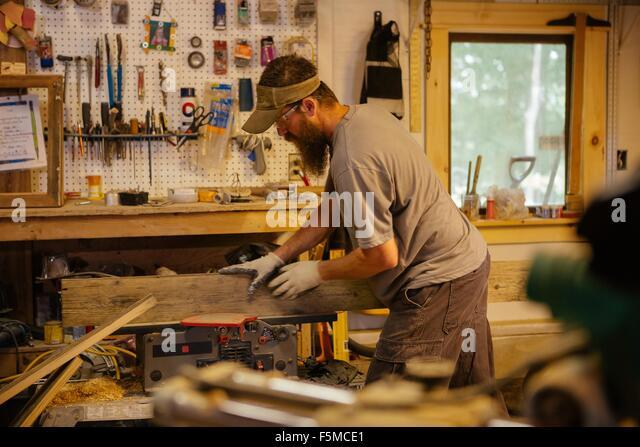 Wood artist in workshop - Stock Image