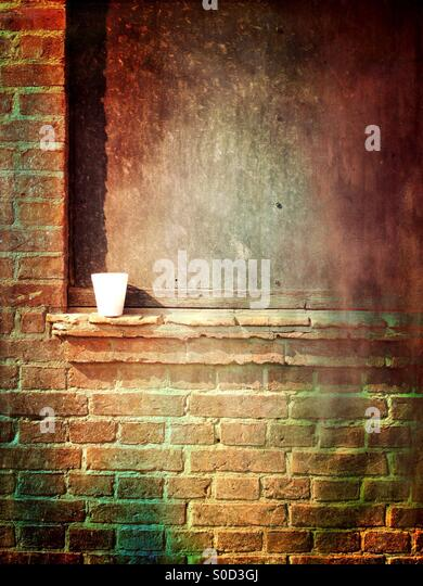 Isolated coffee cup on a wall - Stock Image