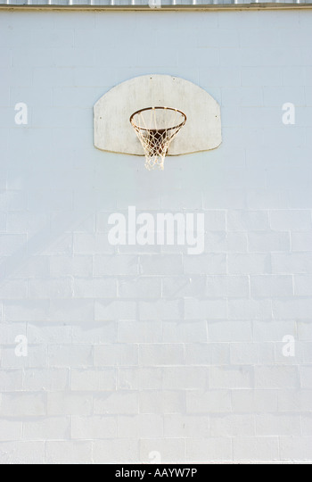 Looking up at an old basketball hoop. - Stock Image