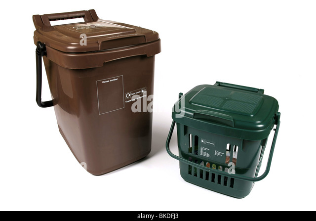 A Brown and green food waste recycling dustbins against a white background - Stock Image