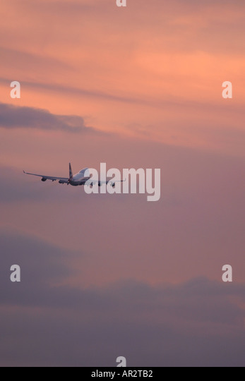 Commercial airplane in flight - Stock Image