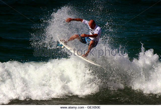 Eleven-time world surfing champion Kelly Slater of the USA rides a wave during a promotional event at Sydney's - Stock Image
