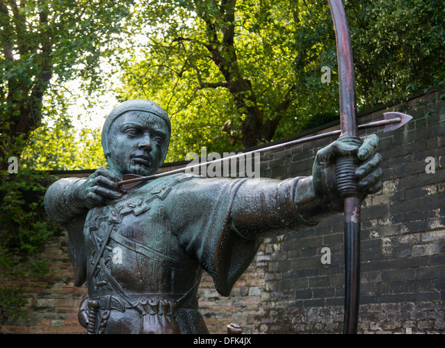 Bronze statue of Robin Hood shooting a bow and arrow at the Nottingham Castle in the United Kingdom. - Stock Image