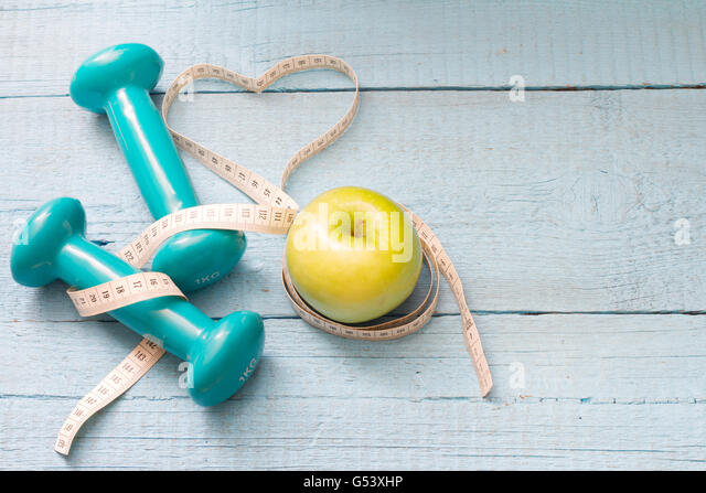 Fitness and diet abstract concept with dumbbells closeup - Stock-Bilder
