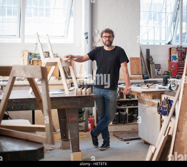 Portrait of a furniture designer maker - Stock-Bilder