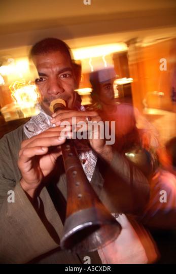 Egyptian musician playing a flute - Stock-Bilder