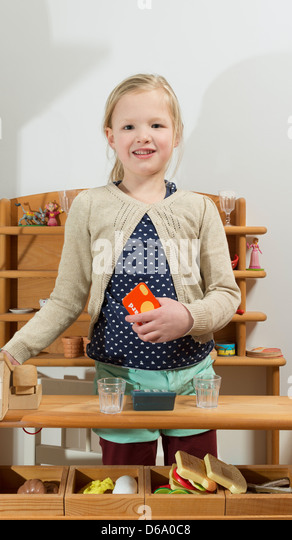 Girl making lunch in kitchen - Stock Image