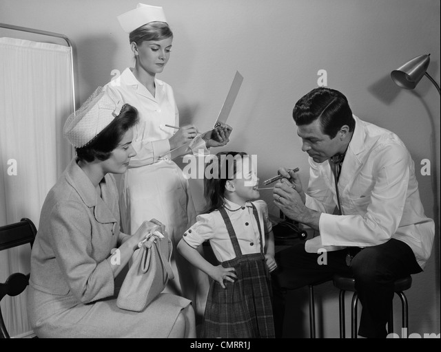 1960s-mother-sitting-watching-man-pediat