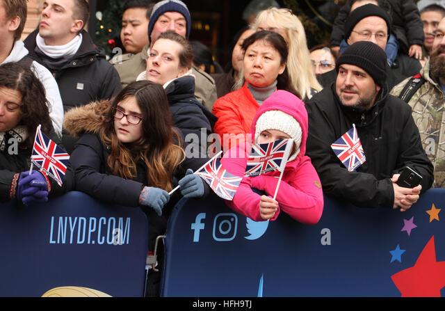 London, UK. 1st January 2017. Spectators seen waving mini Union Jacks along the New Year's Day Parade in London - Stock Image
