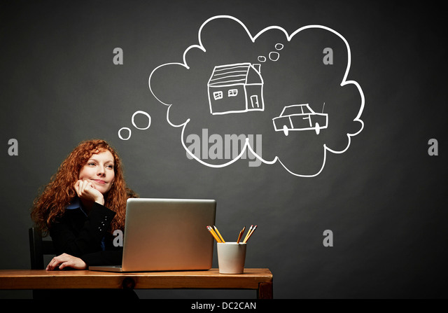 Woman dreaming of new house and car - Stock Image