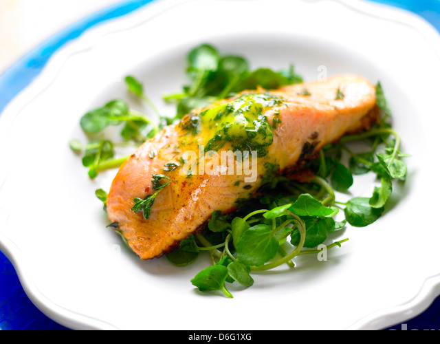 Salmon  and herb butter/step shot - Stock Image